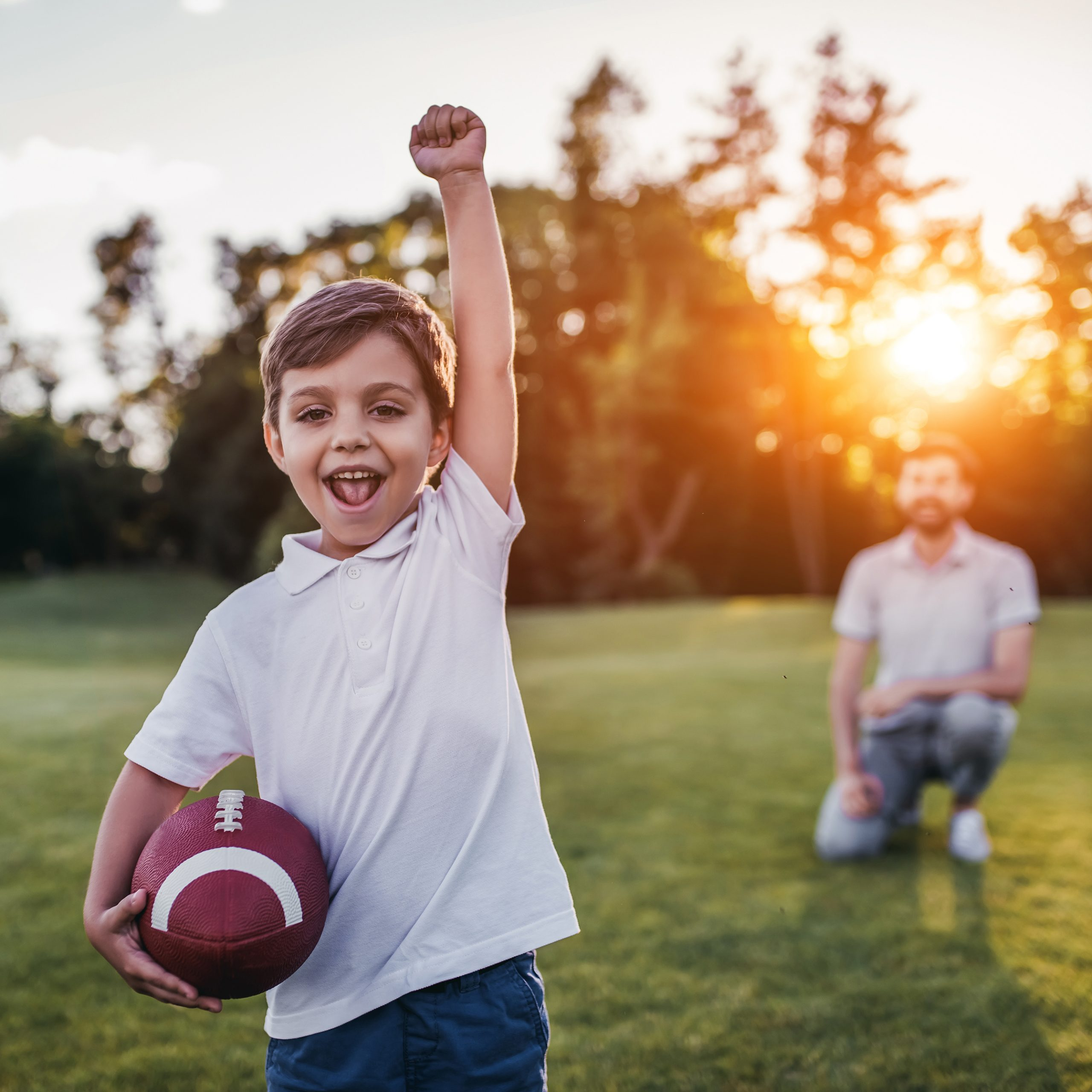 Kid playing catch with a football